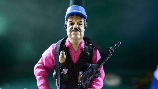 Una figura del narcotraficante Joaquín El Chapo Guzmán - Sputnik Mundo