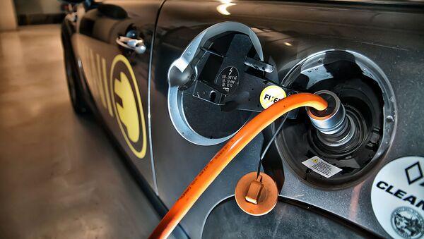 Un automóvil electrico (imagen referencial) - Sputnik Mundo