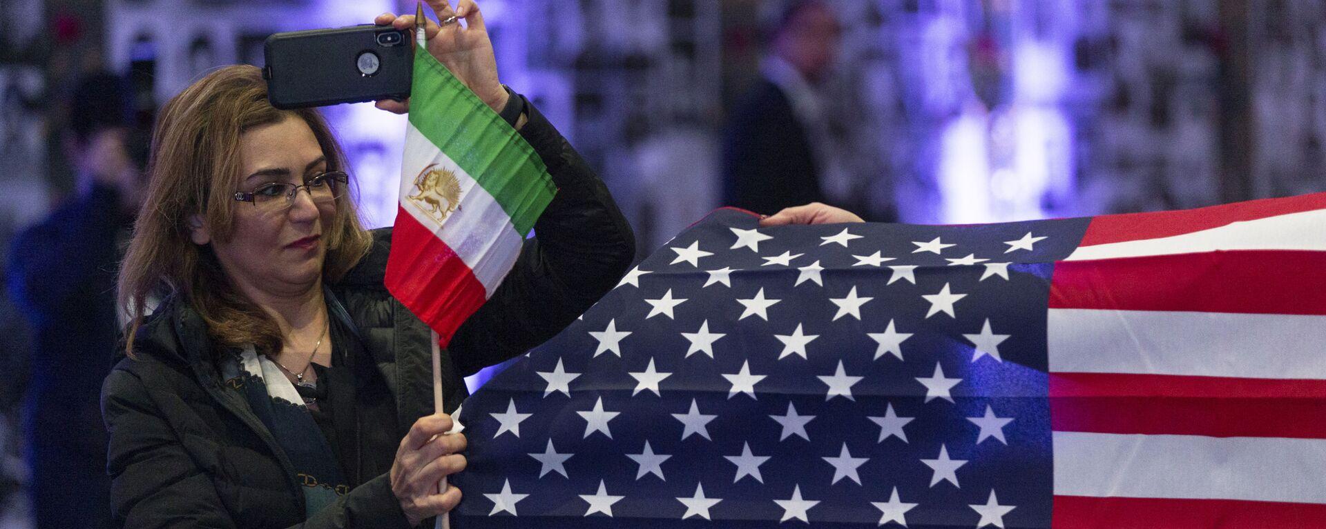 Banderas de EEUU e Irán - Sputnik Mundo, 1920, 05.08.2021
