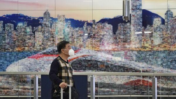 Un turista en Hong Kong - Sputnik Mundo