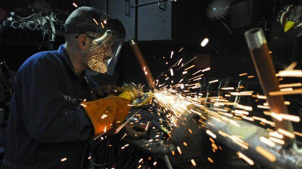 Un trabajador (imagen referencial) - Sputnik Mundo