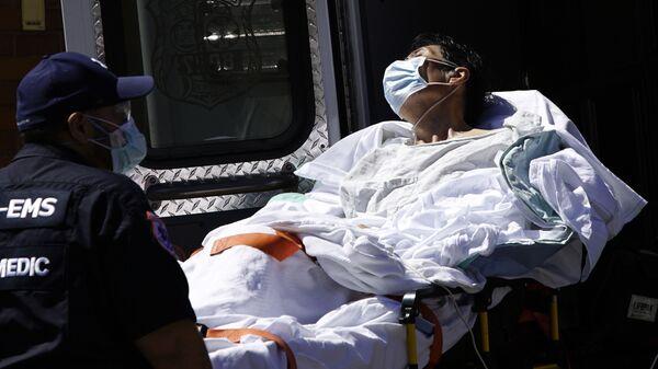 Una persona infectada en Nueva York - Sputnik Mundo
