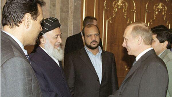 Burhanuddin Rabbani y el presidente ruso, Vladímir Putin, en 2001 - Sputnik Mundo