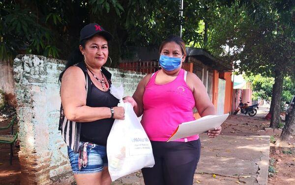 Reparto de canastas por trabajadoras sexuales de la RedTraSex en Paraguay - Sputnik Mundo