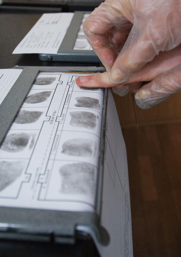 Un escáner de huellas dactilares - Sputnik Mundo