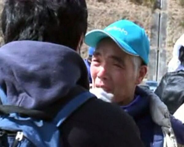 Dos primos se encontraron una semana después del tsunami - Sputnik Mundo