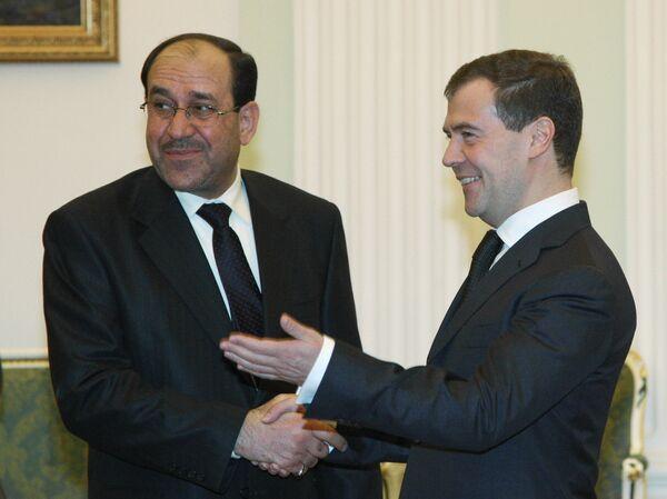 Nuri al Maliki y Dmitri Medvédev - Sputnik Mundo
