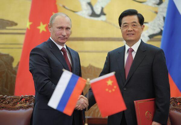 Vladímir Putin y Hu Jintao - Sputnik Mundo