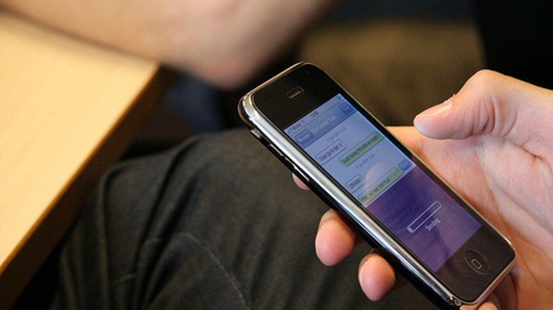 Un iPhone está mandando un mensaje de texto - Sputnik Mundo, 1920, 16.03.2021