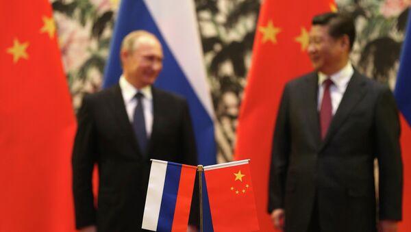 Presidente de Rusia, Vladímir Putin, y presidente de China, Xi Jinping (archivo) - Sputnik Mundo